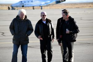 Virgin Galactic's founder Sir Richard Branson and George Whitesides, CEO of Virgin Galactic and The Spaceship Company, congratulate Chief Pilot Dave Mackay and Test Pilot Mark Stucky after first glide flight of Virgin Spaceship Unity (VSS Unity) in Mojave Desert on December 3, 2016. Credit: Virgin Galactic